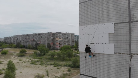 Climber working on a building