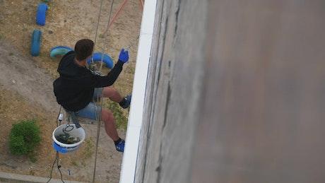 Climber working on building restoration
