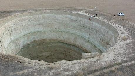 Climbers going down a deep sinkhole
