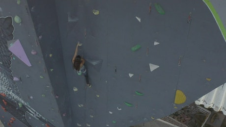 Climbing a large tower to practice mountaineering
