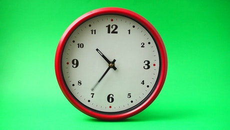 Clock moving fast on a chroma background