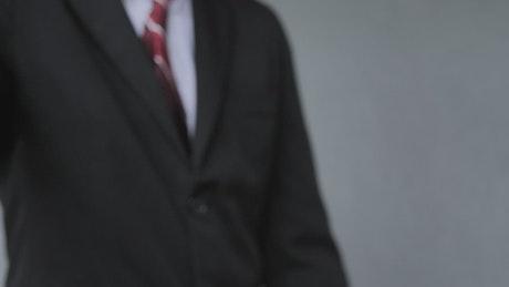 Close-up handshake between formal dressed men