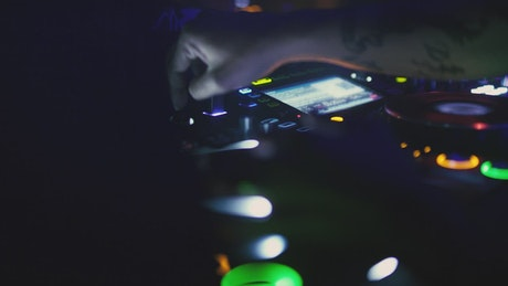 Close up of a DJ playing music at nightclub