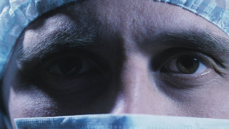 Close up of a doctor's face with mask