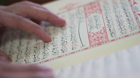 Close up of a person reading the Quran