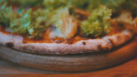 Close up of a pizza with lettuce