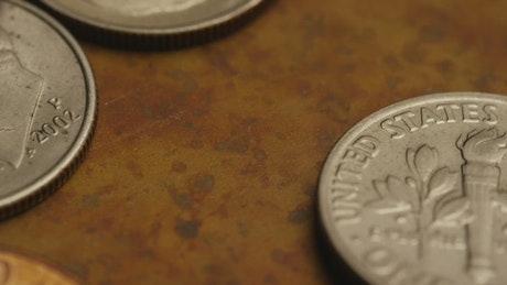 Close up of dollar coins on the table