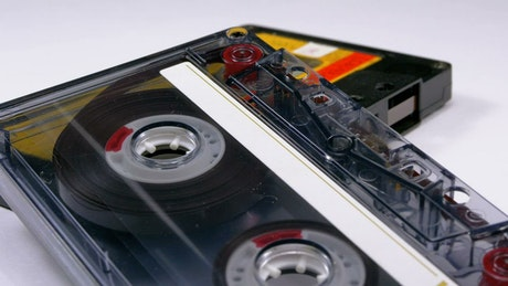 Close up of two vintage audio cassettes rotating