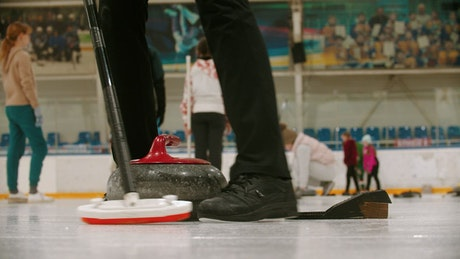 Close up shot of a person playing curling