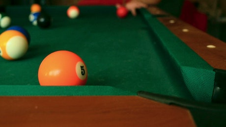 Closeup of billiard balls colliding