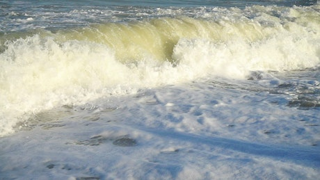 Closeup of breaking waves in slow motion