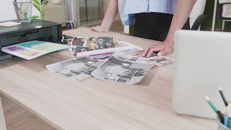 Closeup of creatives looking through ideas on desk