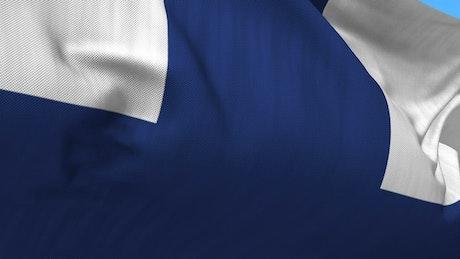Closeup of Finnish flag waving in wind