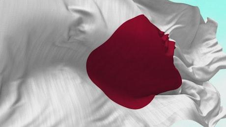 Closeup of Japan flag waving in wind