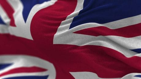 Closeup of United Kingdom flag waving in wind