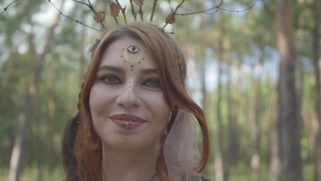 Closeup of woman in fantasy costume dancing in forest