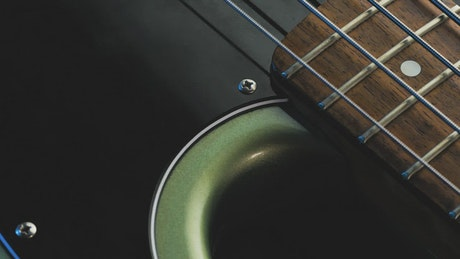 Closeup to an electric bass being played