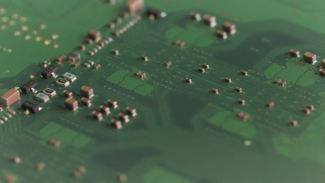 Closeup video of a motherboard with microchips