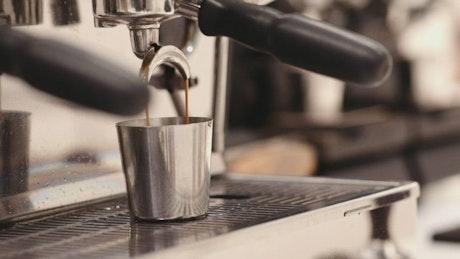 Closeup video of an espresso coffee machine
