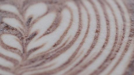 Closeup video of latte flower art