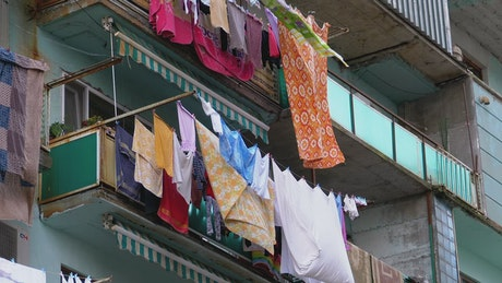 Clothes hanging on a multi story building