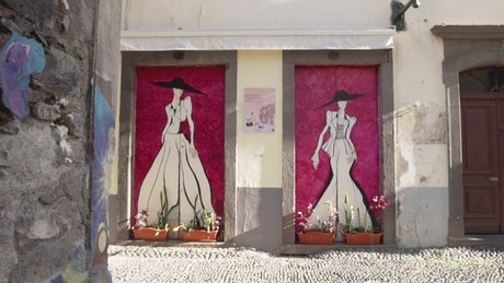 Clothing shop with art on its doorstep
