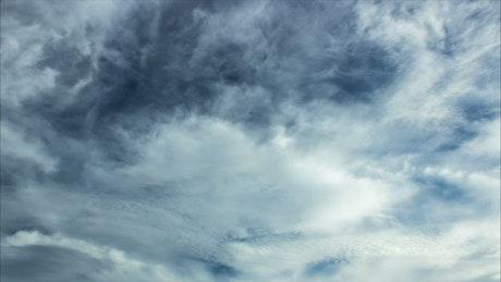 Cloud layers against a dark blue sky