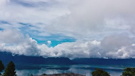 Clouds above a deep blue lake