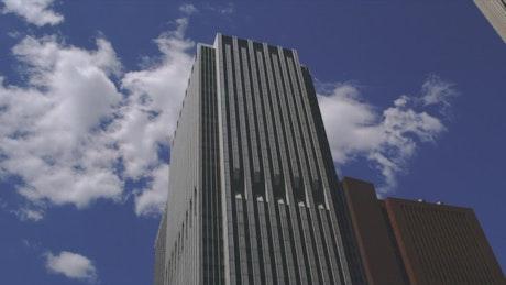 Clouds behind a skyscraper