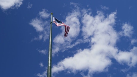 Clouds behind the American flag