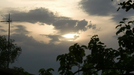 Clouds blocking out the sun during the evening