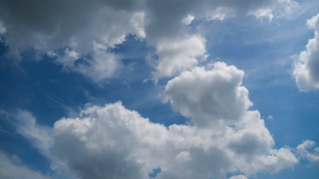 Clouds changing shapes smoothly in the sky