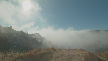 Clouds covering a mountain ridge