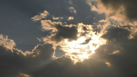 Clouds covering the sun's rays