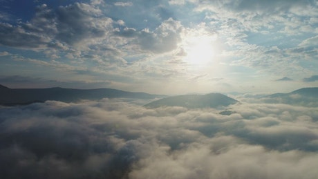 Clouds covering the top of a mountain range