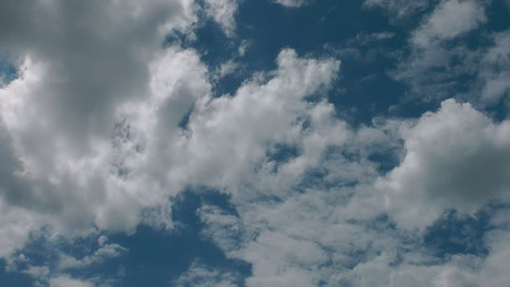 Clouds flying in a clear sky