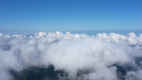 Clouds forming over land