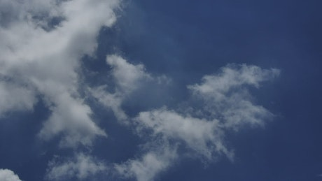 Clouds moving gently with the wind in the blue sky