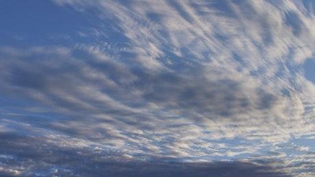 Clouds moving in a blue sky