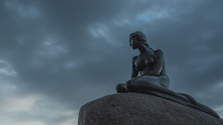 Clouds over a statue in Denmark