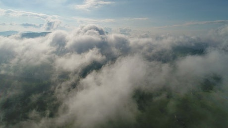 Clouds over mountains, aerial shot