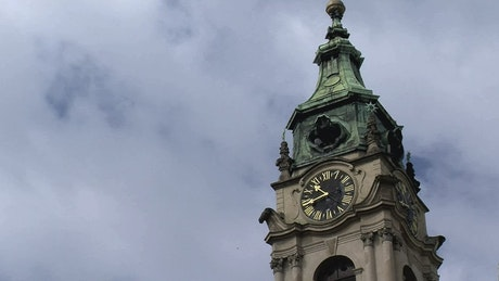 Clouds passing behind a clock tower