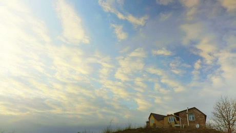 Clouds passing over a country house