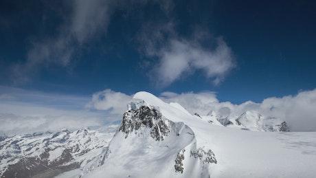 Clouds touching the tip of Matterhorn Mountain