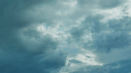 Cloudy sky covered with thick clouds moving with the wind