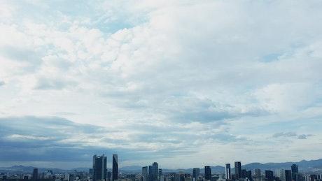 Cloudy sky over a contemporary city