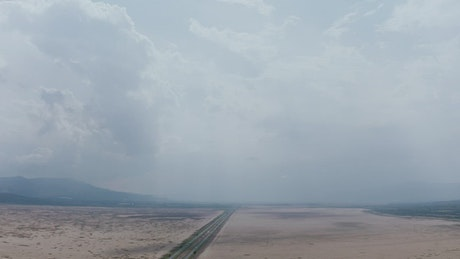 Cloudy sky with dry lagoon