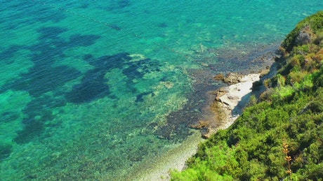 Coast with crystal clear sea water in summer