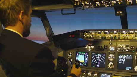 Cockpit console view of a plane flying