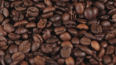 Coffee beans falling in reverse